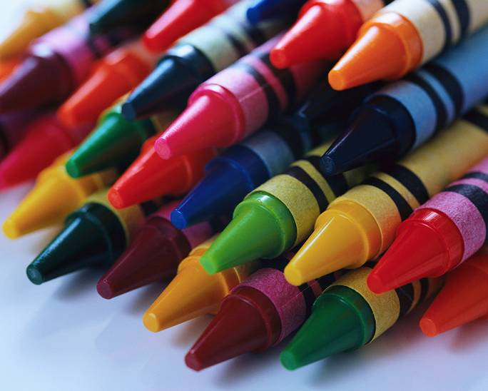 Piles of coloured crayons