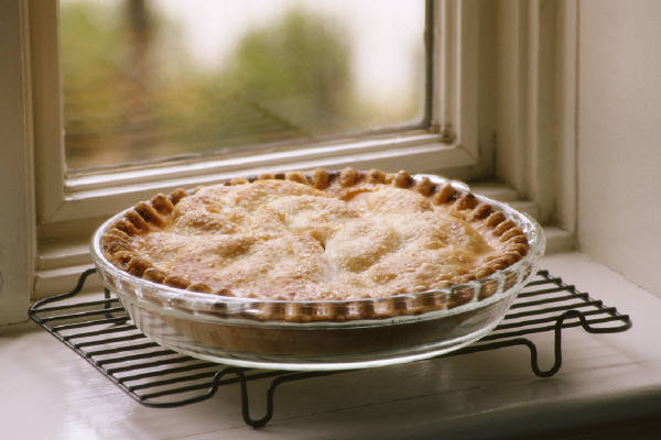 A freshly cooked pie sitting on the window sill