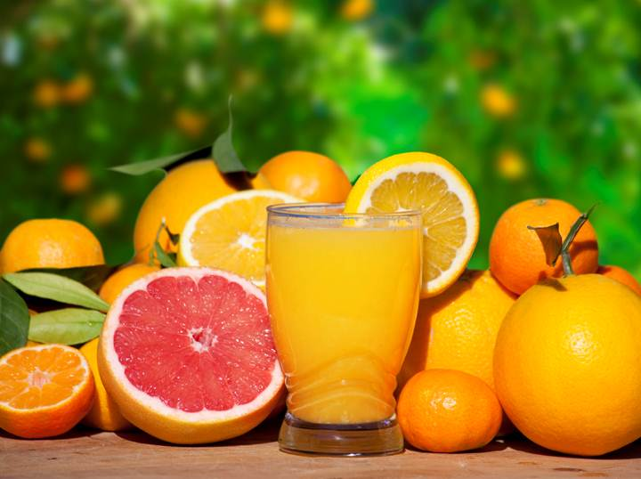 A refreshing image of citrus fruit and a jug of juice from aforementioned.