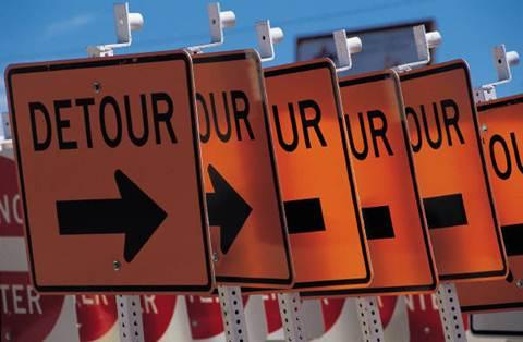 Orange detour road signs.
