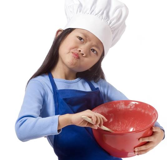 A girl considering what she's going to try cooking next. Yum, the possibilities.