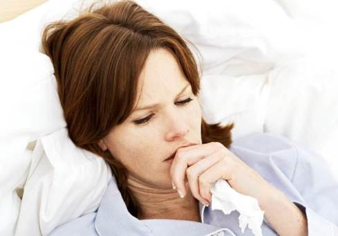 A woman in bed with flu. If only we all looked this photogenic when we have the flu...