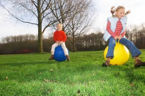 Children bouncing on balls.