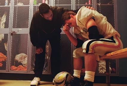 A coach giving his football player a pep talk. Don't you wish you had someone on hand to do the same for your writing?