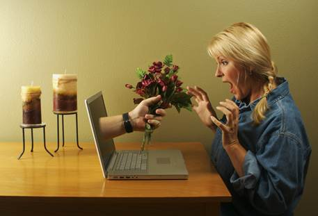 A writer suddenly finds herself being handed a bunch of flowers from her laptop.