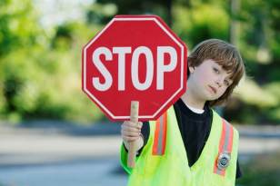 A child holding a stop sign, because you should really stop reading this blog...like right now.