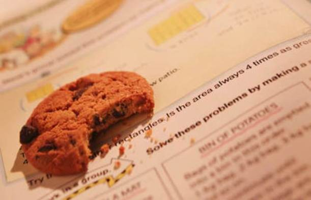 A half-eaten cookie on a book.