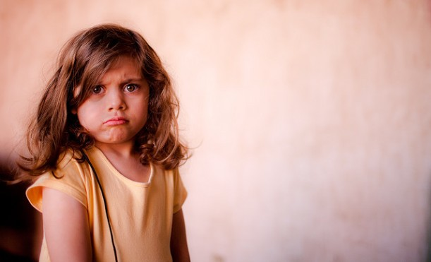 A girl looking very grumpy. Obviously she's been saying can't too often.